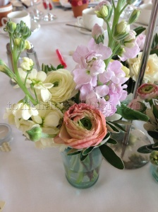 Simple_stems_in_coloured_jam_jar_by_Todich_Floral_Design